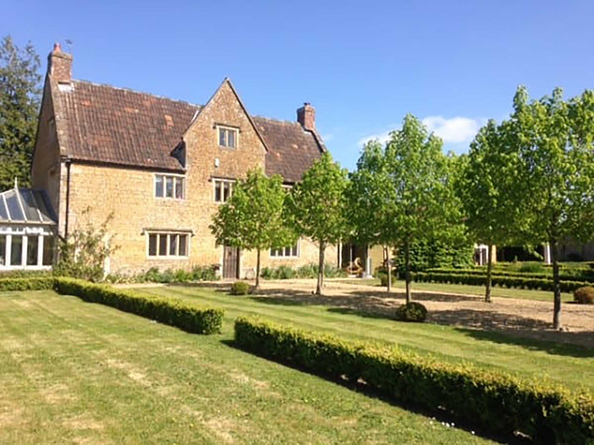 Grade II listed house with 35ft kitchen extension, 5 bedrooms, stables, annexe and 6 acres.