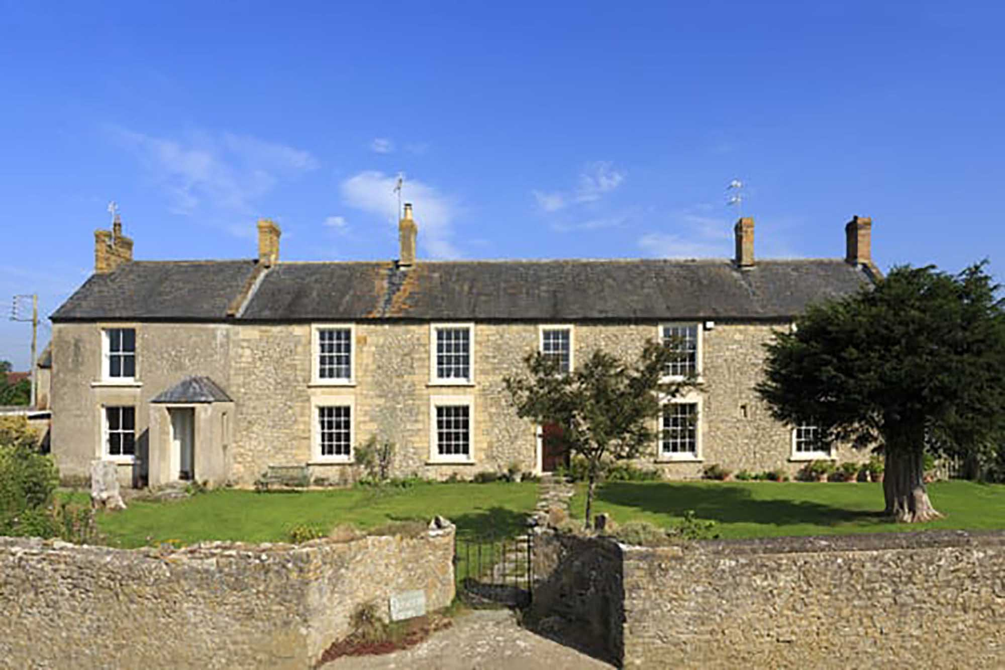 A substantial farmhouse with land and cottages near Bruton