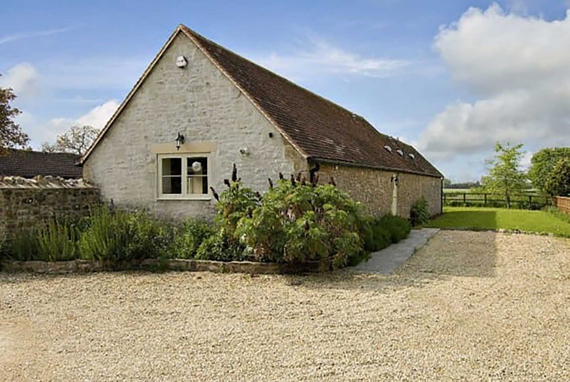 Detached barn conversion set back from the lane with garden, parking in peaceful location with good views