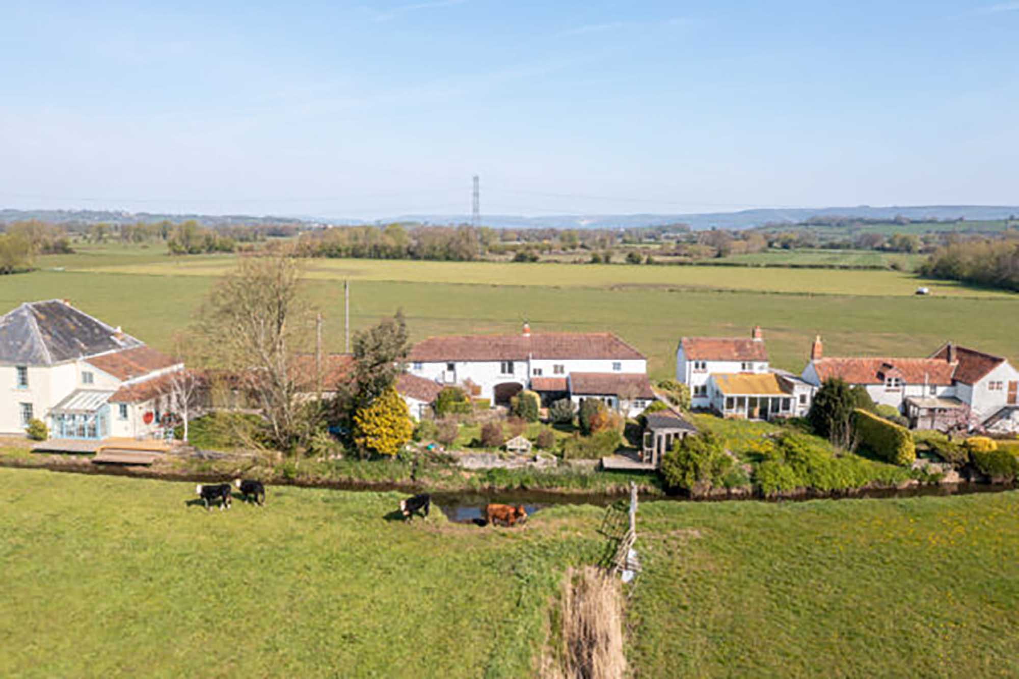 6 bedroom house , outbuildings , approx 26 acres land and woodland